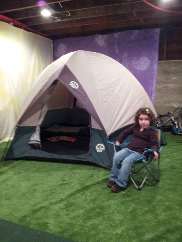 Indoor campsite setup in a basement