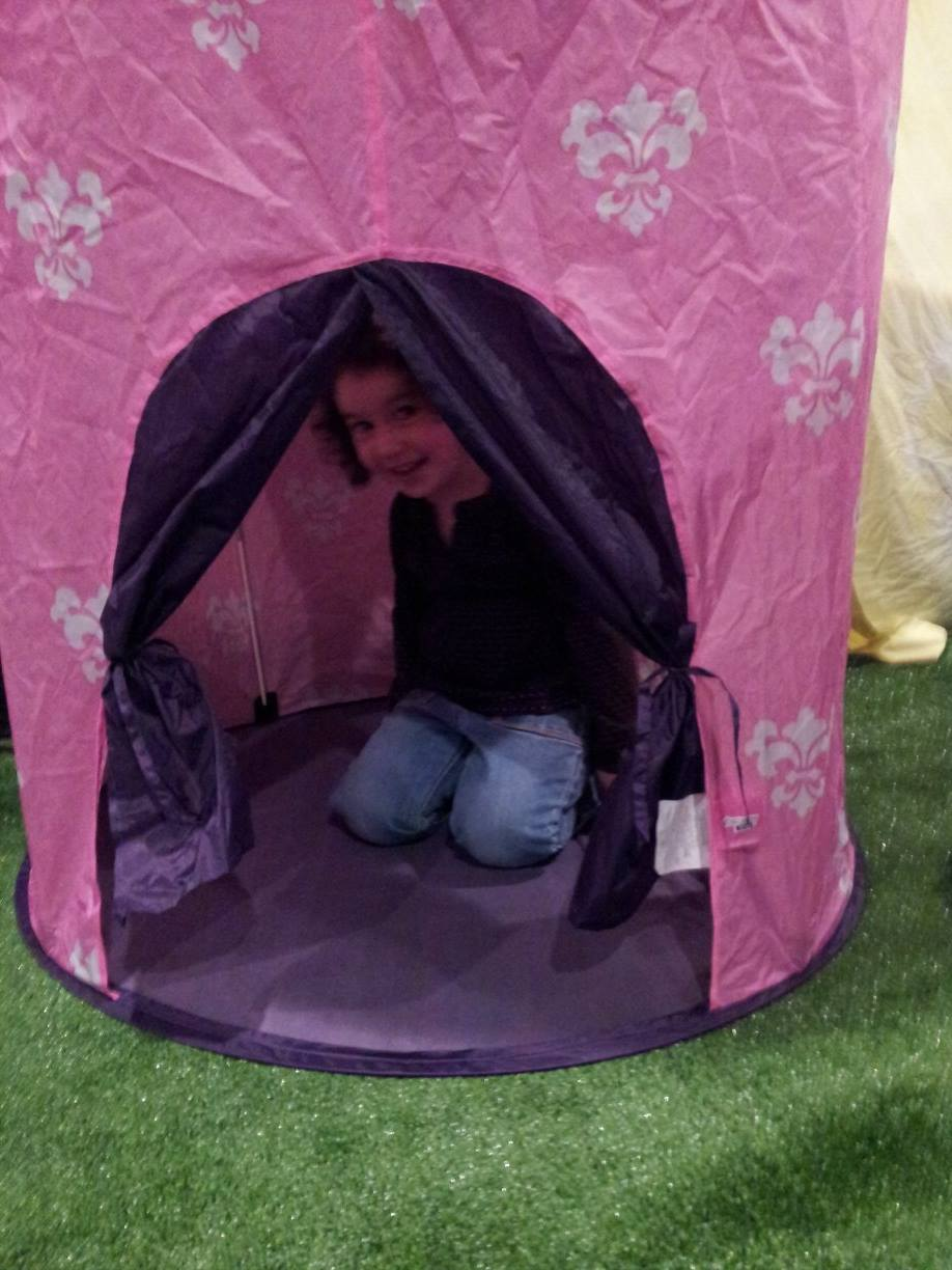 Little camper playing inside mini tent