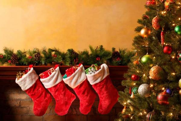 Christmas stockings hung by fire