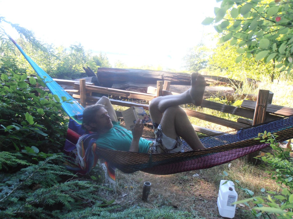 Man reading a book in hammock