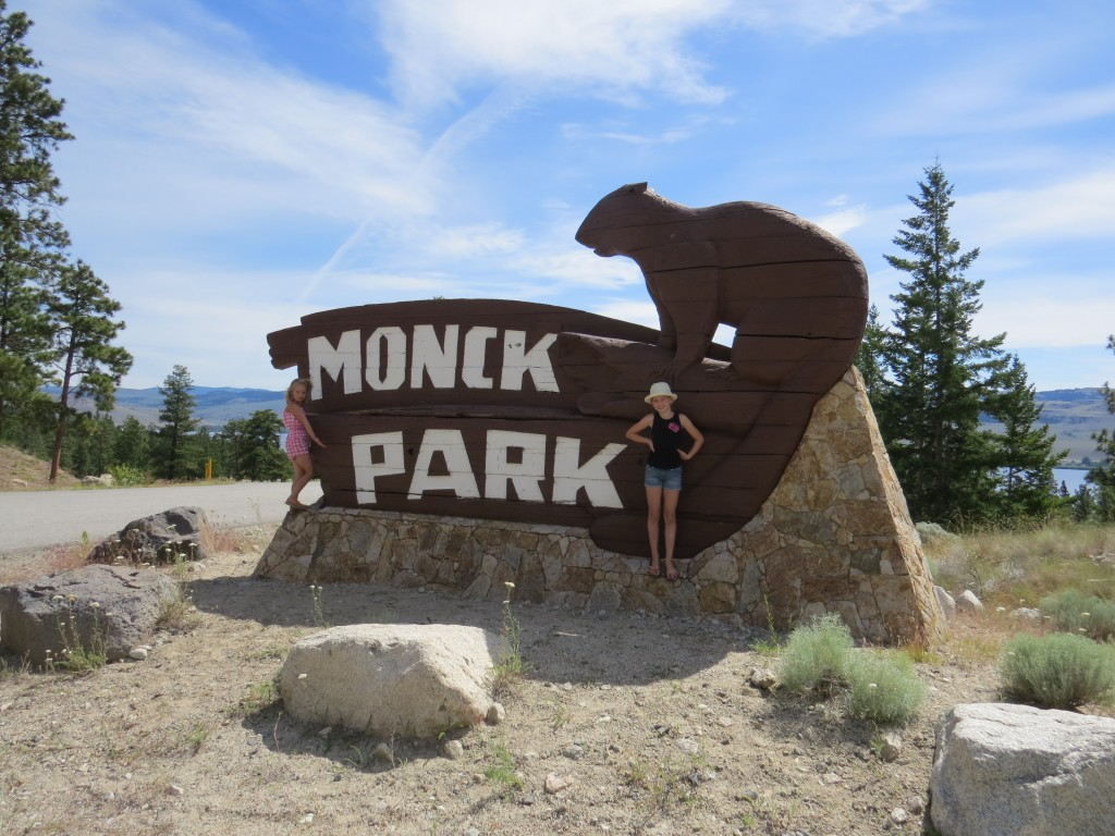 Two girls standing beside Monck Park Sign