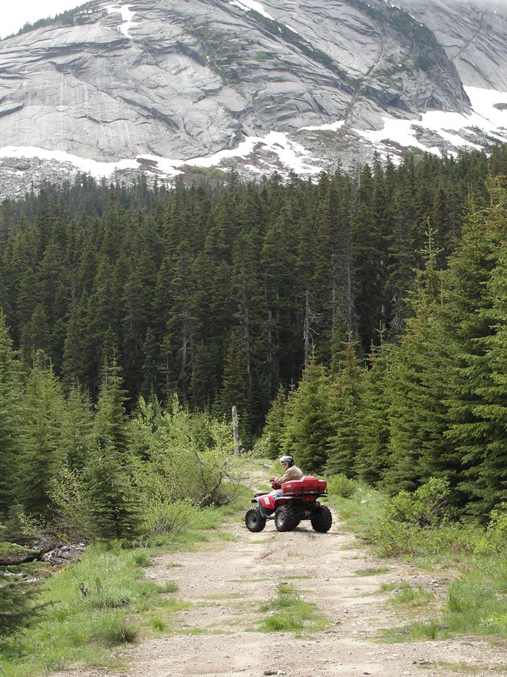 Man on quad with mountain in background