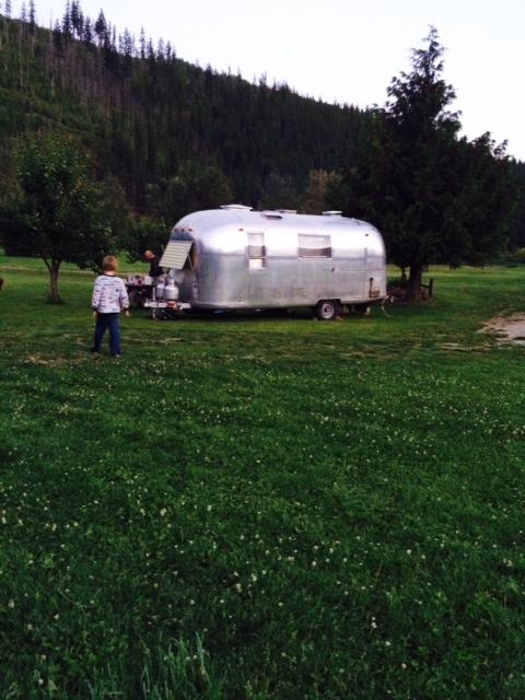 Little boy walking towardscamping trailer