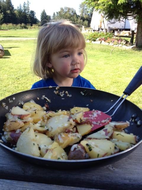 Little girl watching breakfast being made