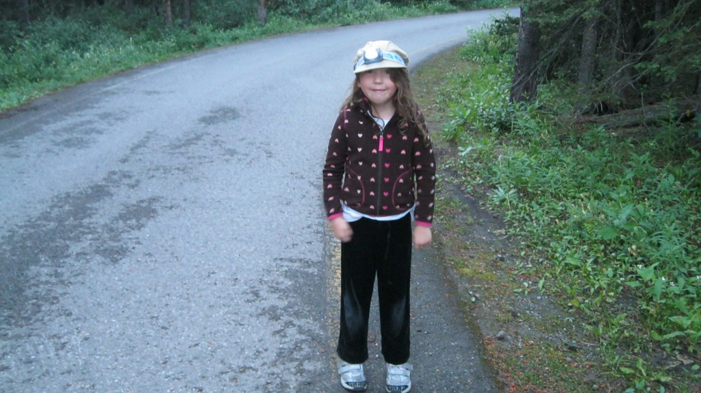 Little girl with headlamp in a campground