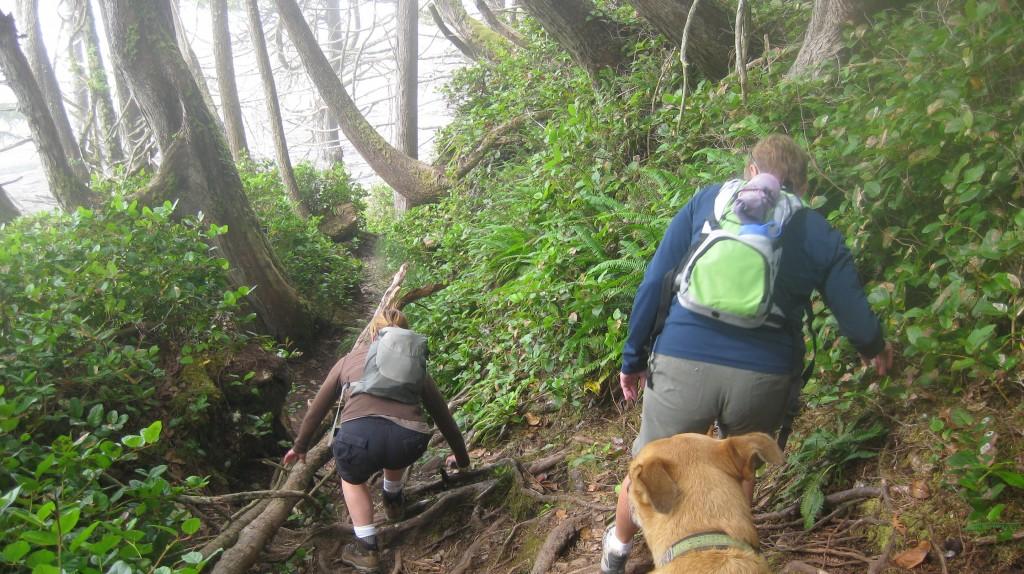 Two women hiking down the Juan de Fuca Marine Trail