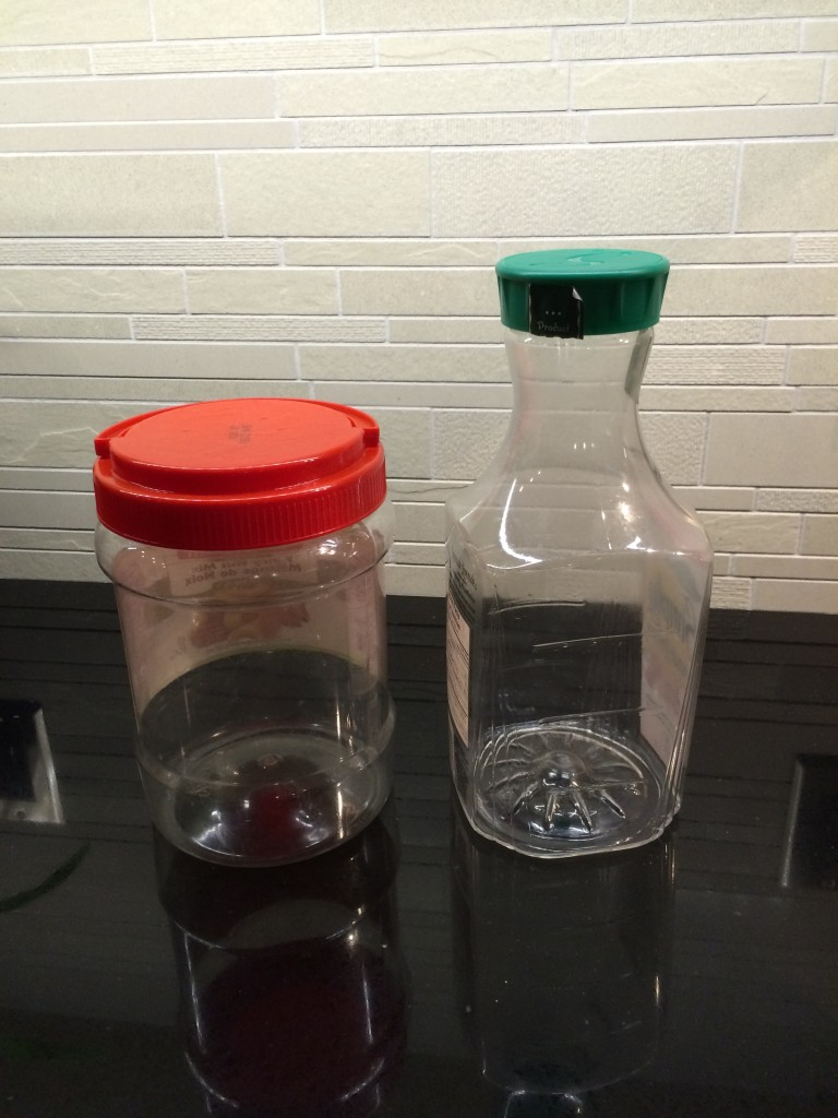 Two empty containers on a counter