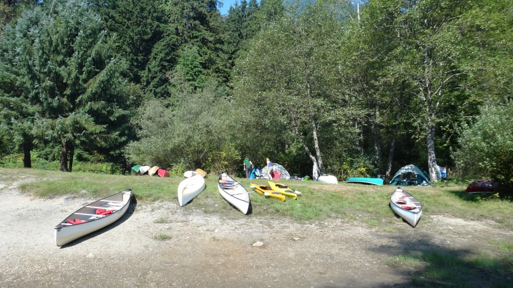 Canoes pulled up to the shore in front of Widgeon Creek Campsite