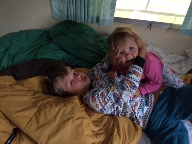 Two children in their bed in an RV