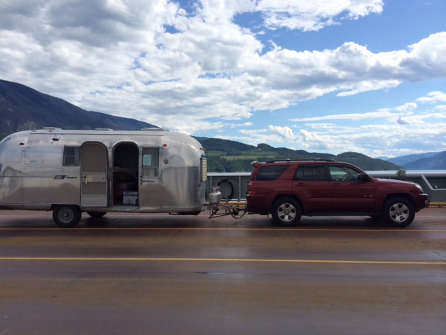 RV Trailer and truck at roadside stop