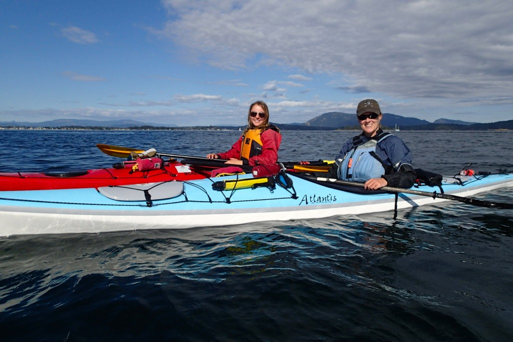 Man and woman kyaking in the Gulf Islands