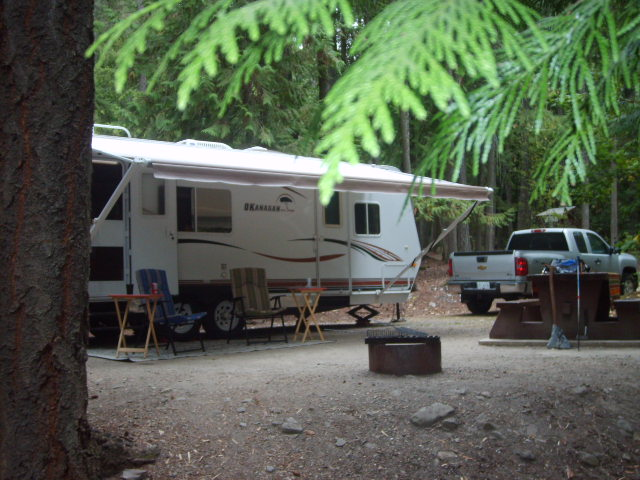 An RV trailer parked at a campsite