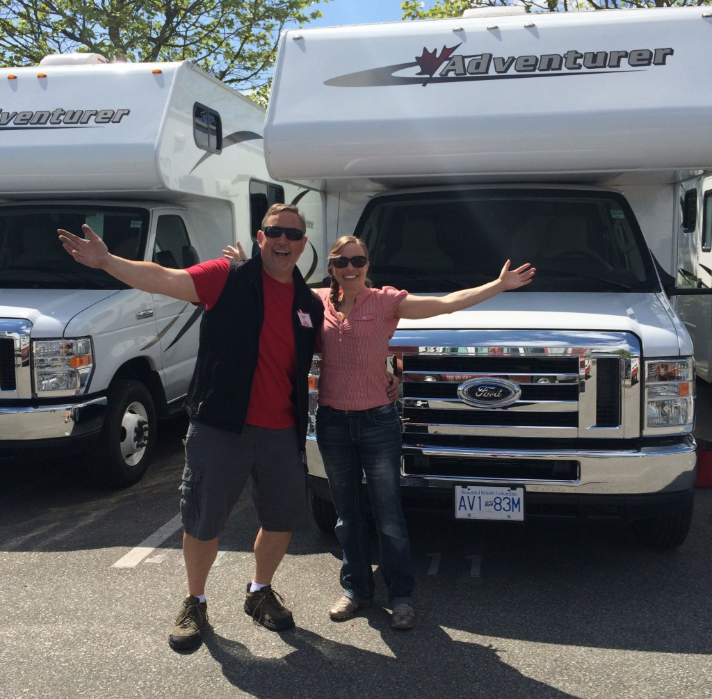 Woman and man standing in front of an RV