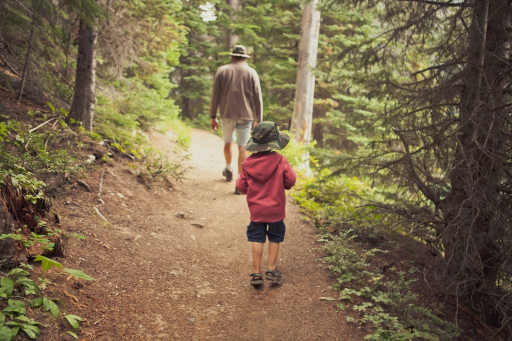 Father and son hiking a trail