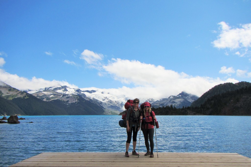 Two women in front of a lake