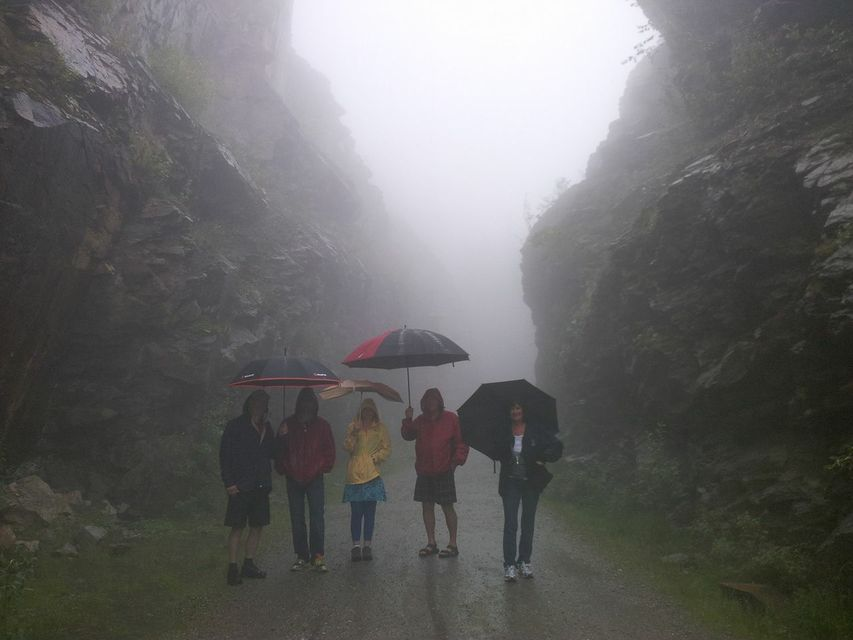 Family on a hike in the rain
