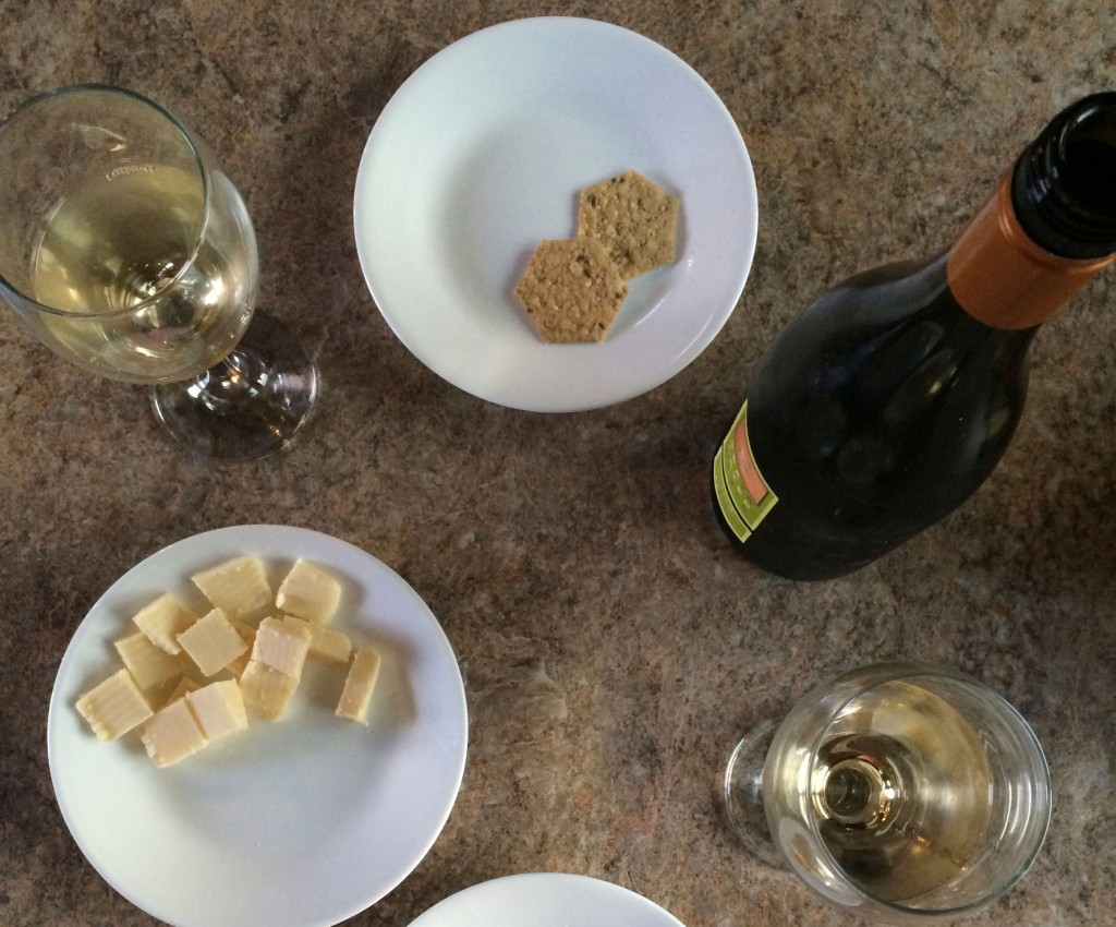 A picture of wine and cheese