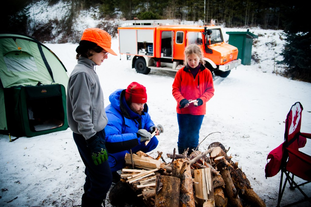 Building campfire while winter camping