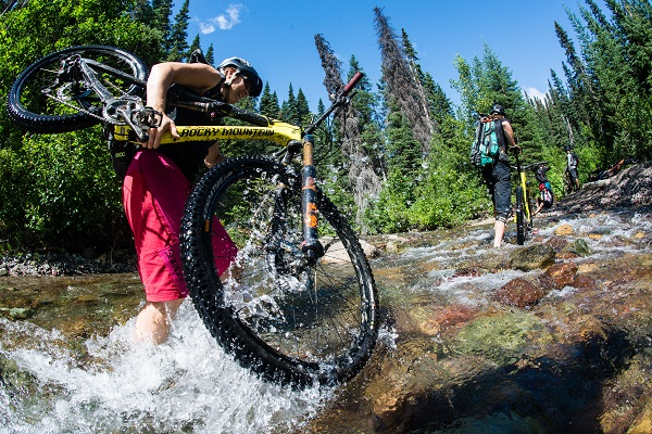 Carrying the bike across the creek in Smithers