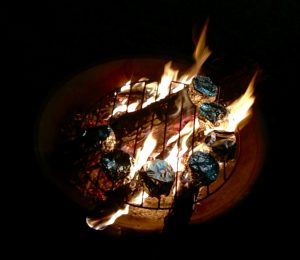Orange peel bakes on the fire