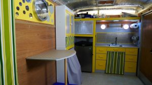 Converting Utility Trailer RV the cupboards, table and sink installed