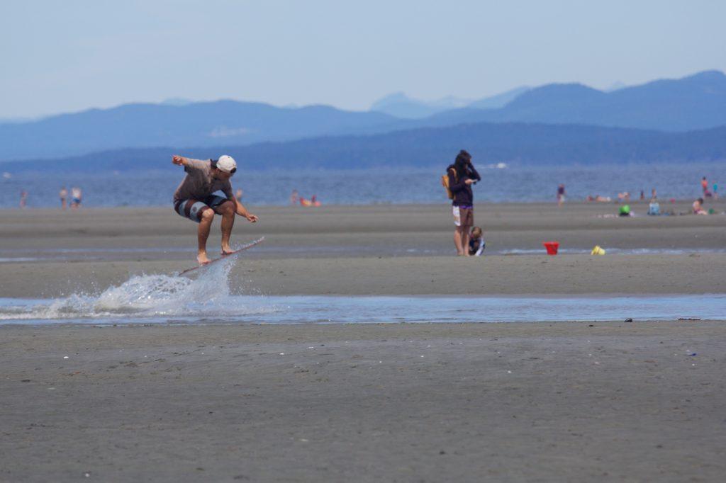 Skimboarding at Parksville Beach | Photo: Parksville Qualicum Beach Tourism