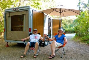 Relaxing outside Utility Trailer RV conversion