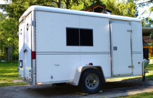 Converting Utility Trailer RV - Painted window and pinstripes make trailer look more like a camper trailer