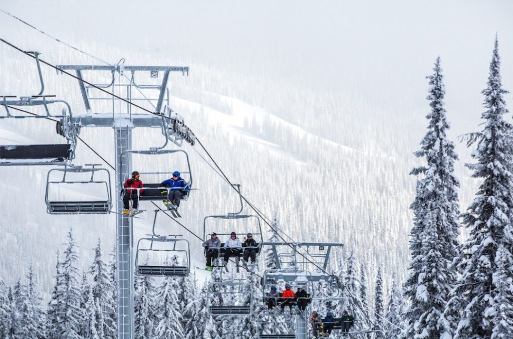Skiers on the chairlift at Sun Peaks Resort. Photo Credit Destination BC/Ryan Creary