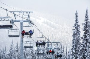 Skiiers on the chairlift at Sun Peaks Resort. Photo Credit Destination BC/Ryan Creary